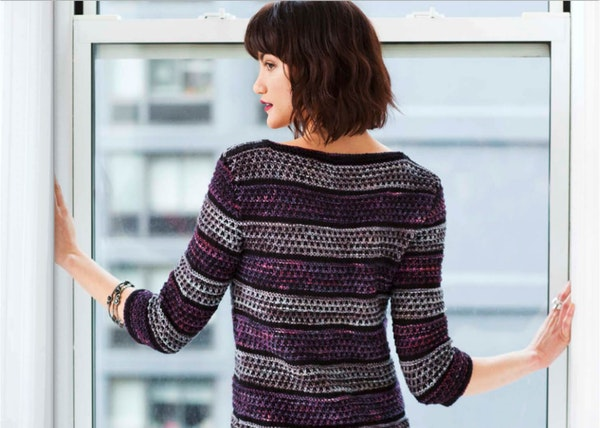 image of a women from the back looking back and wearing wool diver with malabrigo yarn