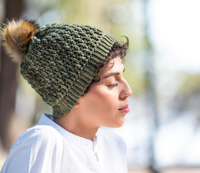 Woman wearing a scarf made with malabrigo yarn.